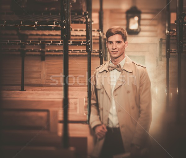 Handsome young man in coat inside vintage train coach  Stock photo © Nejron