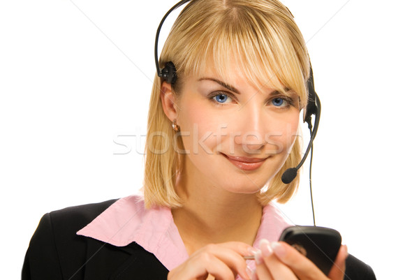 Beautiful hotline operator with cellphone in her hands isolated  Stock photo © Nejron