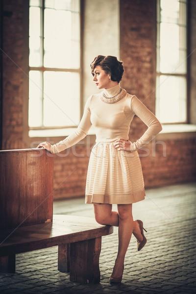 Klasszikus stílus fiatal nő vasútállomás nő fiatal Stock fotó © Nejron