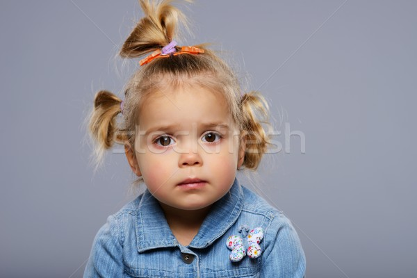 Disappointed little girl isolated on grey background  Stock photo © Nejron