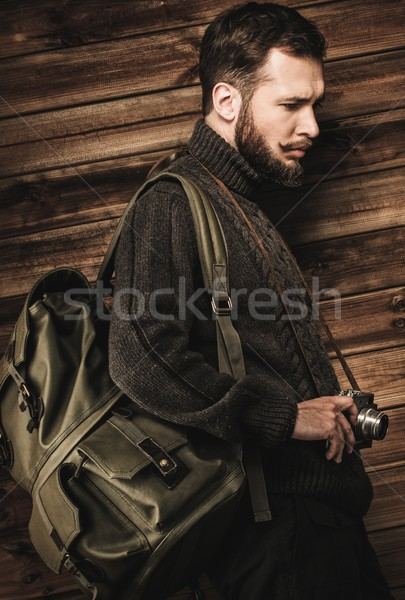 Homem bonito cardigã mochila casa interior Foto stock © Nejron