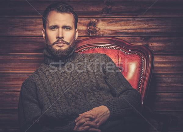 Jóképű férfi visel kardigán fából készült vidéki házbelső Stock fotó © Nejron