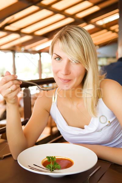 Młoda kobieta jedzenie zupa pomidorowa restauracji piękna tabeli Zdjęcia stock © Nejron