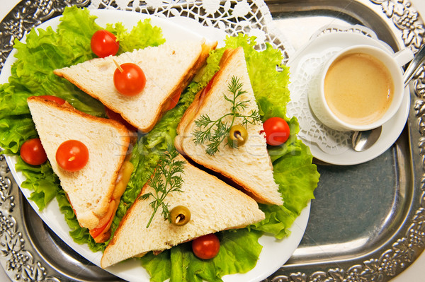 Eating on the run. Fresh and tasty home-made canape sandwiches Stock photo © Nejron