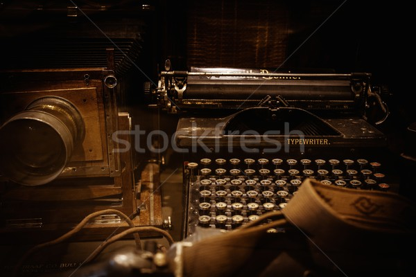 Stock photo: Old camera and typewriter on a table