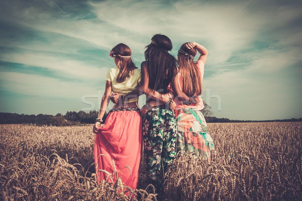 Multi-ethnic hippie girls  in a wheat field  Stock photo © Nejron