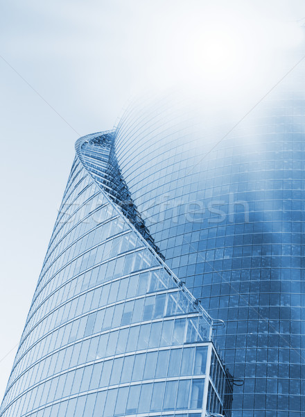 Modern office building with a sun flare Stock photo © Nejron