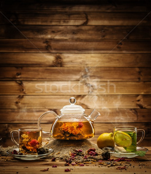 Teapot and glass cups with  tea against wooden background  Stock photo © Nejron