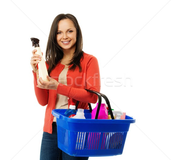 Beautiful cheerful brunette woman with basket full and bottle of cleanser  Stock photo © Nejron