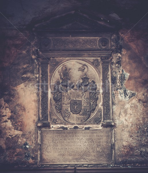 Coat of arms and old text on memorable wall Stock photo © Nejron