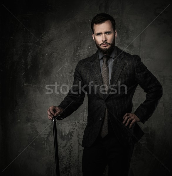 Handsome well-dressed man with walking stick  Stock photo © Nejron