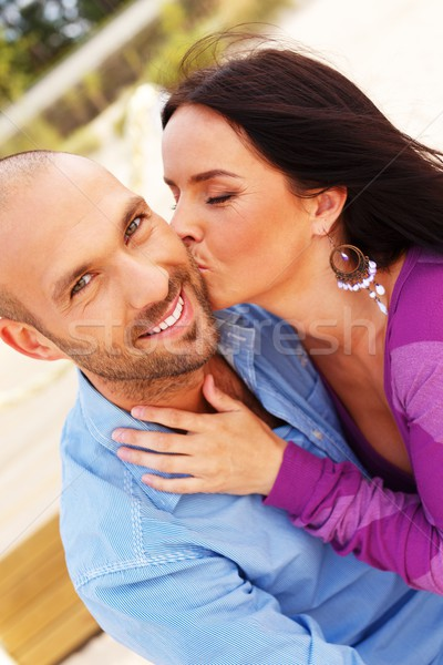 Happy smiling middle-aged couple on a beach Stock photo © Nejron