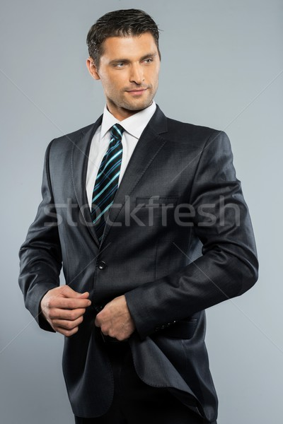 Well-dressed handsome man in black suit and tie  Stock photo © Nejron
