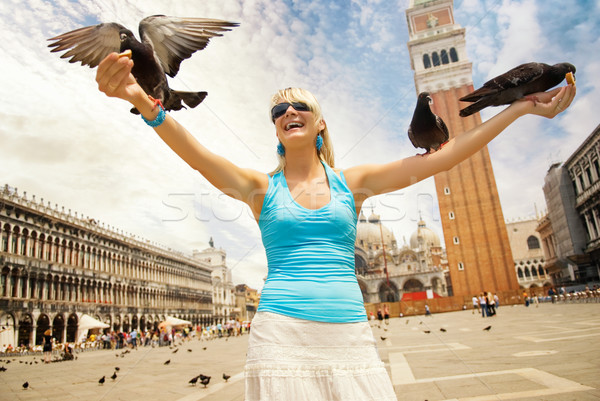 Beautiful young woman feeding pigeons Stock photo © Nejron
