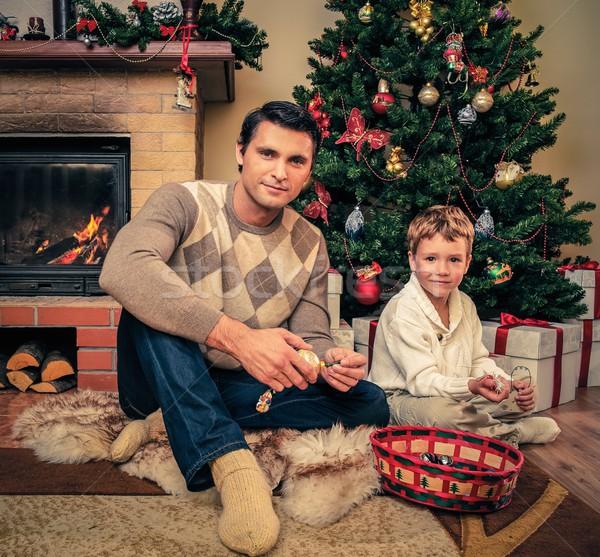 Fiatal apa fia kandalló karácsony díszített házbelső Stock fotó © Nejron