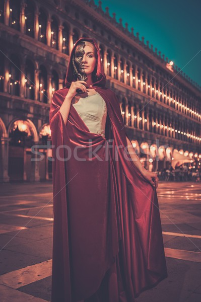 Woman with a mask on San Marco square in Venice  Stock photo © Nejron