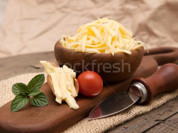 Grated yellow cheese Stock photo © Neliana