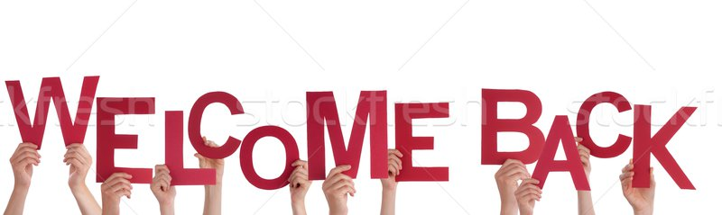 Hands Holding Welcome Back Stock photo © Nelosa