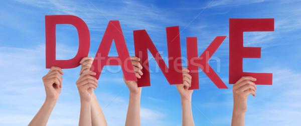 Hands Holding Danke in the Sky Stock photo © Nelosa