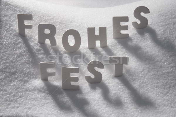 White Word Frohes Fest Means Merry Christmas On Snow Stock photo © Nelosa