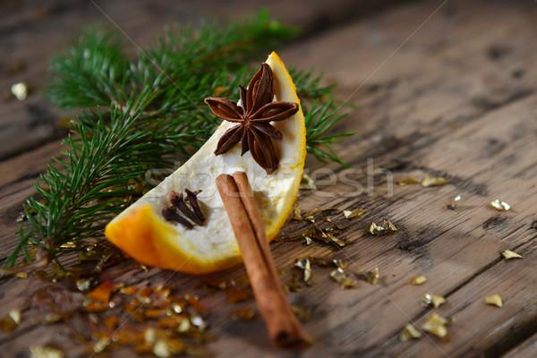 Karácsonyi étel dekoráció narancs fahéj fenyő ág Stock fotó © Nelosa