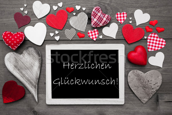 Gray Chalkbord, Red Hearts, Herzlichen Glueckwunsch Means Congratulations Stock photo © Nelosa
