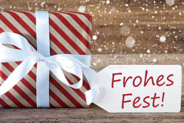 Present With Snowflakes, Text Frohes Fest Means Merry Christmas Stock photo © Nelosa
