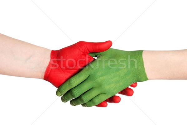 Rojo verde apretón de manos pintado mano aislado Foto stock © Nelosa