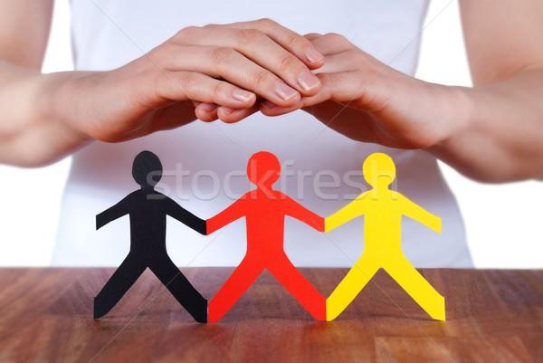 hands protecting people Stock photo © Nelosa