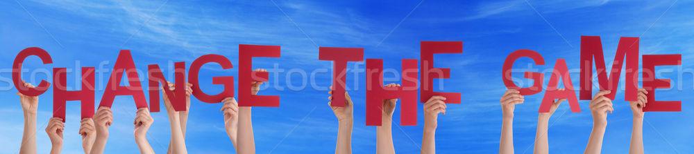 People Hands Holding Red Word Change The Game Blue Sky Stock photo © Nelosa