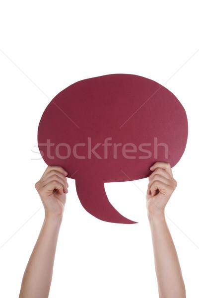 Piros üres szöveglufi kéz tart szövegbuborék Stock fotó © Nelosa