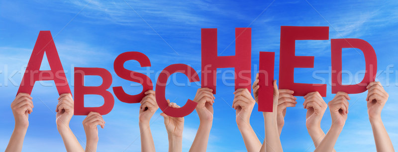 People Holding German Word Abschied Means Goodbye Blue Sky Stock photo © Nelosa
