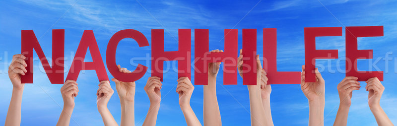 People Holding Straight German Word Nachhilfe Means Coaching Blu Stock photo © Nelosa