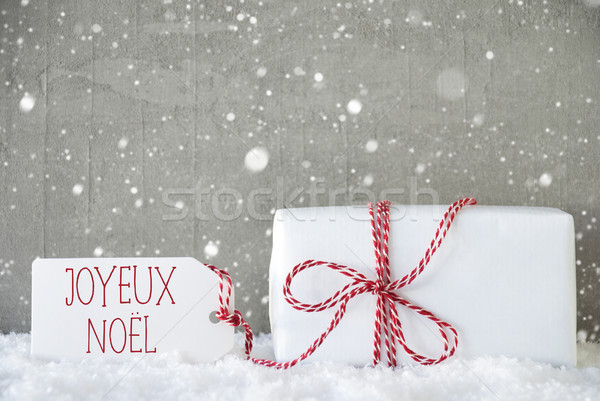 Gift, Cement Background With Snowflakes, Joyeux Noel Means Merry Christmas Stock photo © Nelosa