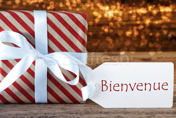 Atmospheric Christmas Gift With Label, Bienvenue Means Welcome Stock photo © Nelosa