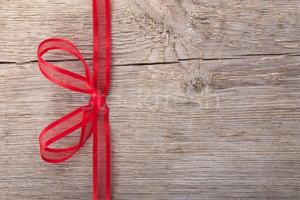 a red bow on wood Stock photo © Nelosa