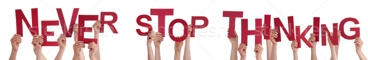 People Hands Holding Red Word Never Stop Thinking  Stock photo © Nelosa