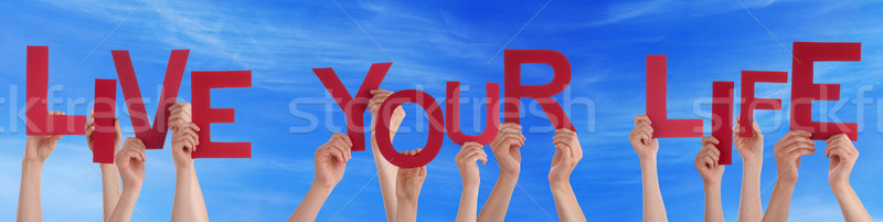 People Hands Hold Red Word Live Your Life Blue Sky Stock photo © Nelosa