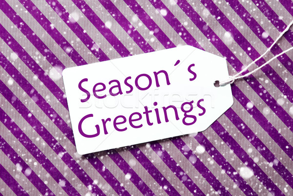 Label On Purple Wrapping Paper, Snowflakes, Text Seasons Greetings Stock photo © Nelosa