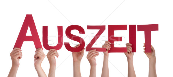People Holding Straight German Word Auszeit Means Downtime Stock photo © Nelosa