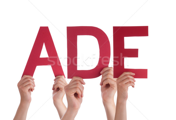 People Holding Straight German Word Ade Means Goodbye Stock photo © Nelosa