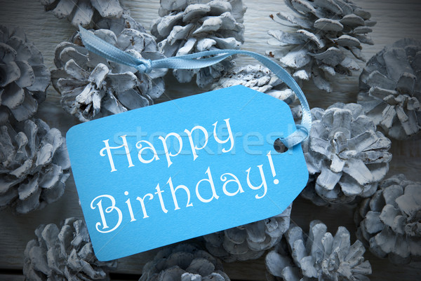Light Blue Label On Fir Cones With Happy Birthday Stock