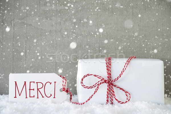 Gift, Cement Background With Snowflakes, Merci Means Thank You Stock photo © Nelosa
