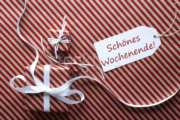 Two Gifts With Label, Schoenes Wochenende Means Happy Weekend Stock photo © Nelosa