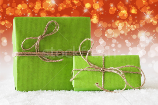 Two Green Gifts On Snow, Complementary Red Bokeh Effect Stock photo © Nelosa
