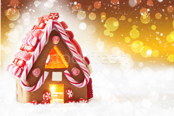 Stock photo: Gingerbread House, Golden Background With Bokeh And Snowflakes, Copy Space
