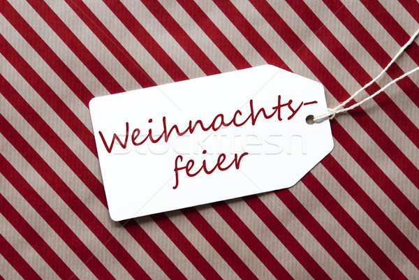 Label On Red Wrapping Paper, Weihnachtsfeier Means Christmas Party Stock photo © Nelosa