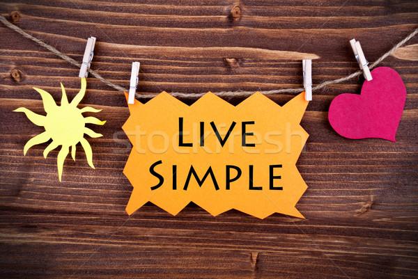 Orange Lable Saying Live Simple Stock photo © Nelosa