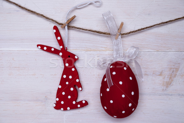 Red Easter Bunny And Easter Egg Hanging On Line Stock photo © Nelosa