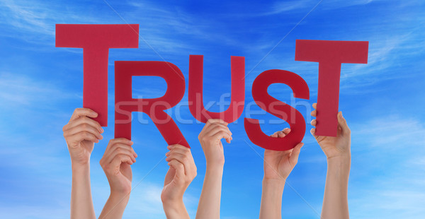 Many People Hands Holding Red Word Trust Blue Sky Stock photo © Nelosa